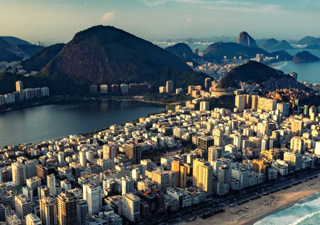 Aerial picture of high rise apartments with sugar loaf mountain in the distance in Iponema Brazil