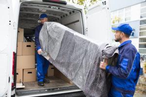 Delivery men loading a van