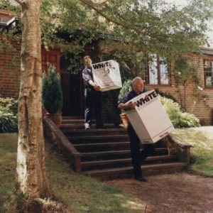 two porters carrying boxes image White & Company