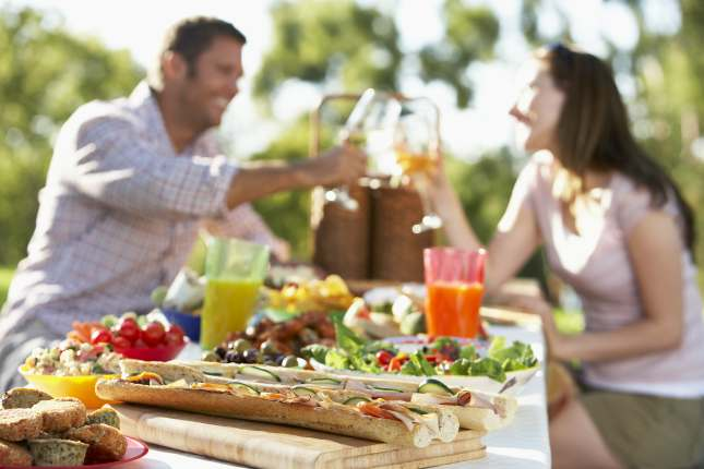 Couple Dining Al Fresco, Toasting Each Other
