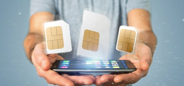 Businessman holding Different size of a smartphone sim card 3d