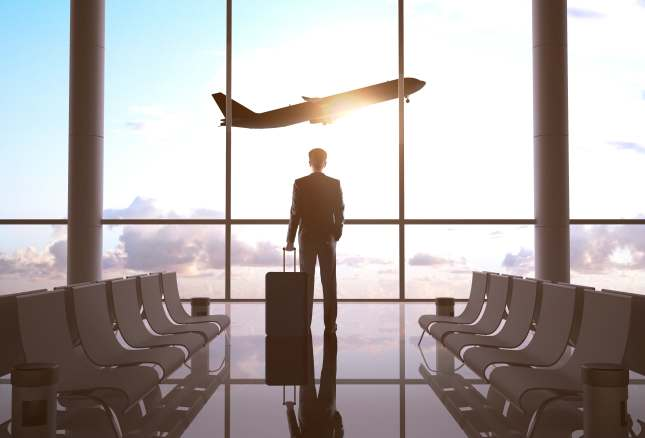 businessman in airport and airplane in sky
