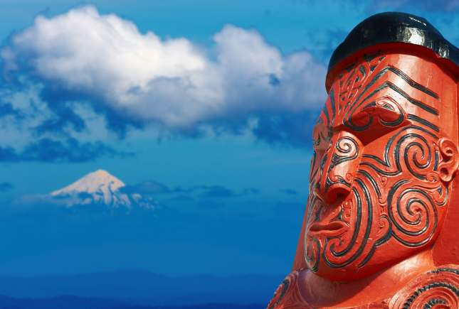 Traditional maori carving and Taranaki Mount, New Zealand