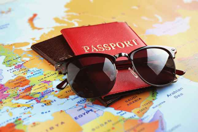 Sunglasses and passports on map
