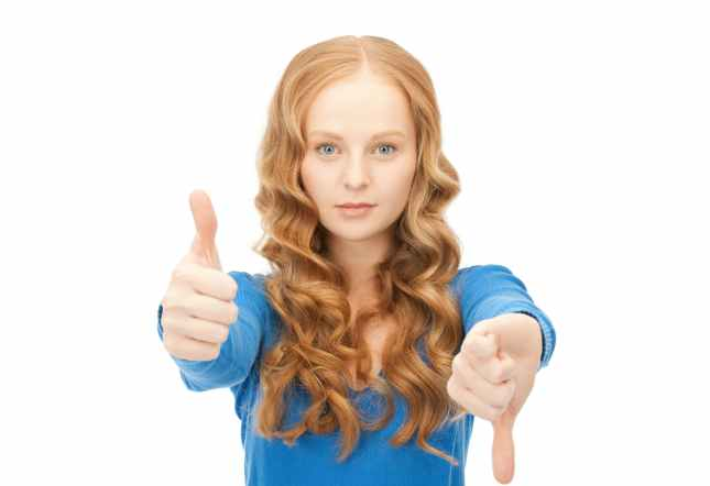 girl with thumbs up and down