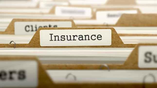 insurance word on folder