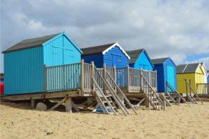 Removals Felixstowe, Beach huts on a sandy beach